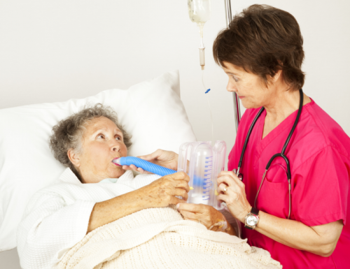 nurse performing breathing exercise with patient